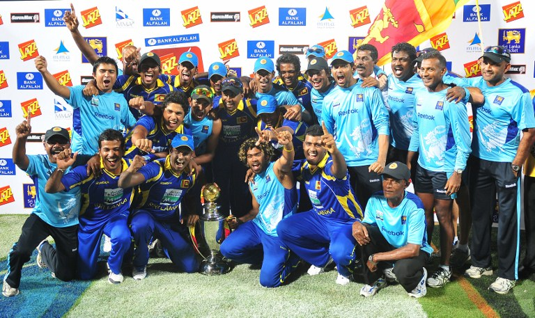 Sri Lankan cricketers pose for photographers after victory in the fifth and final one-day international (ODI) match between Sri Lanka and Pakistan at the R. Premadasa Stadium in Colombo on June 18, 2012.