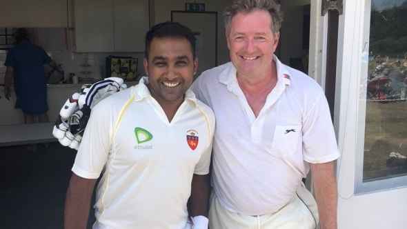 Piers Morgan poses for a photo with Mahela