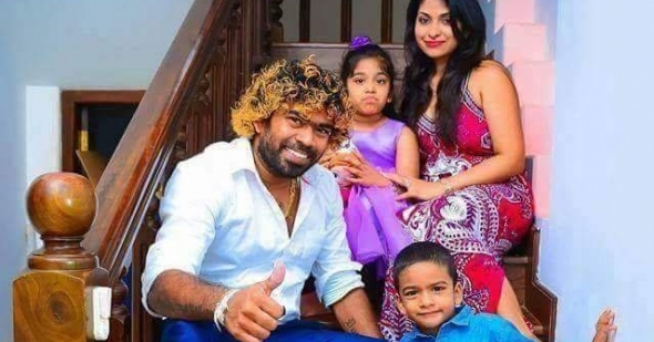 Malinga with his wife and kids