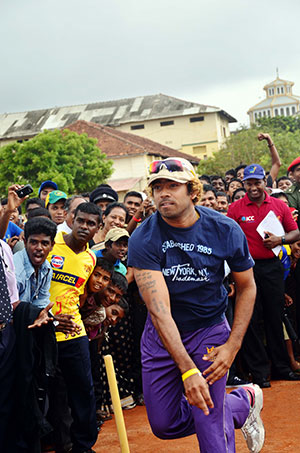 Lasith Malinga bowls at the opening ceremony of the Murali Harmony Cup at St. Patrick's College in Jaffna. © The Murali Cup 2012