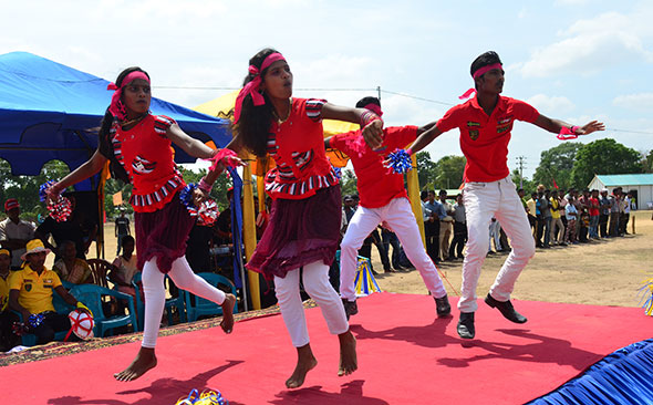 Dancers on the boundary line at Kilinochchi Central College.