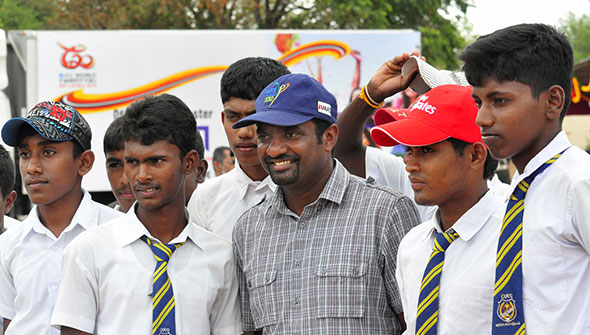 Muttiah Muralitharan poses for photos with children in northern Sri Lanka who flocked to watch the matches.