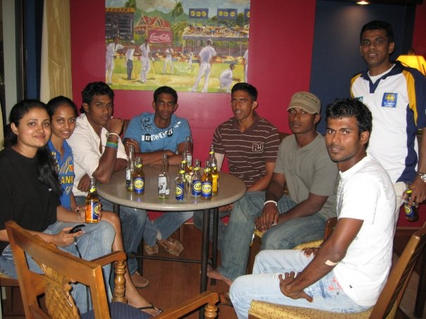 Cricketers at a pub with their friends