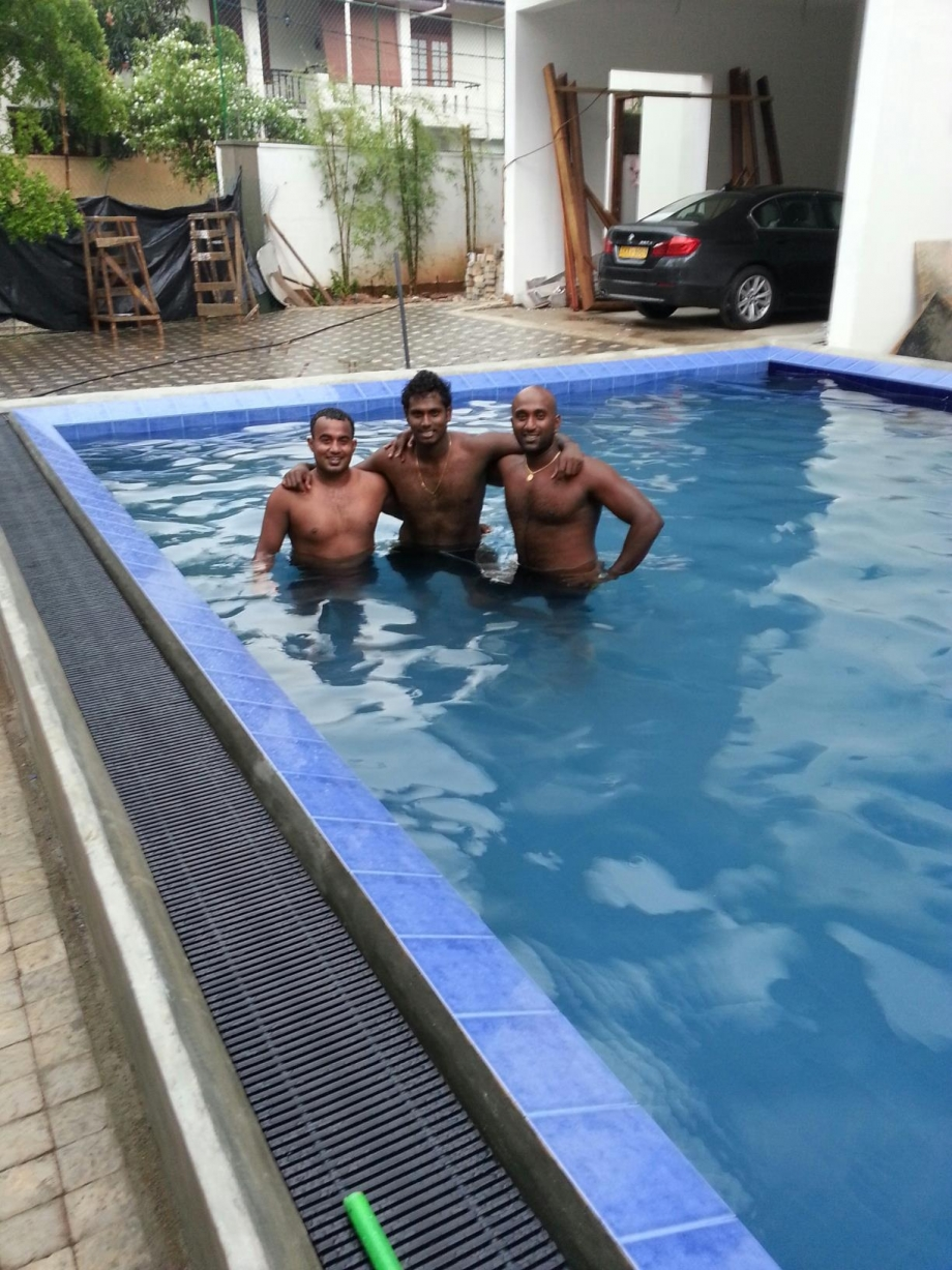 Angelo Mathews cooling off in a pool with friends