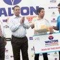 Roshen Silva receiving the man of the match award