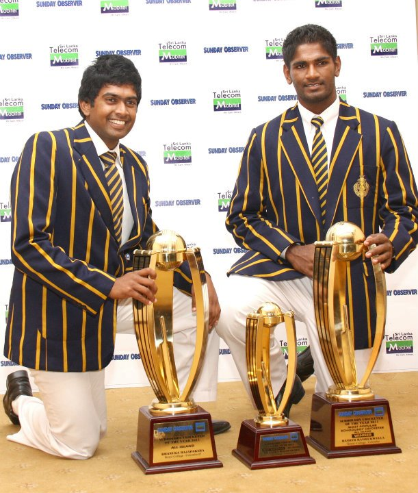 Rajapaksa and Rambukwella pose with 2011 Schoolboy Cricketer of the Year trophies