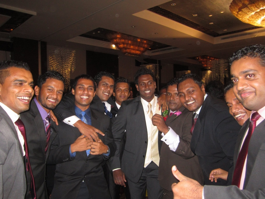 Mathews poses with his friends at his wedding reception