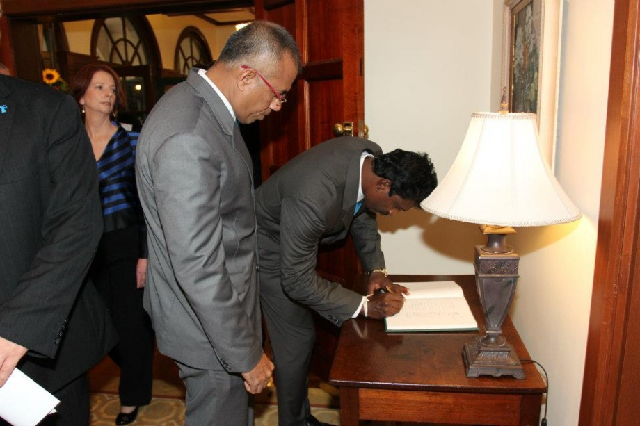 Support staff sign guestbook at Australian PM's residence