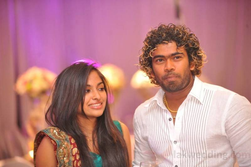 Lasith Malinga and his wife at an event