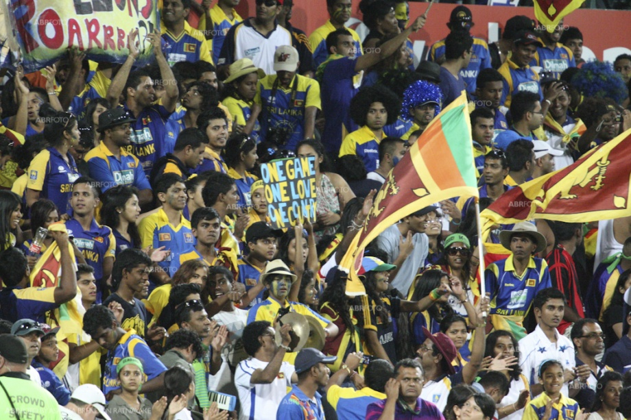 Colourful Sri Lankan spectators cheer their team to victory