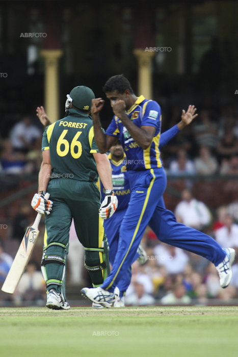 Farveez Maharoof celebrates the wicket of Peter Forrest