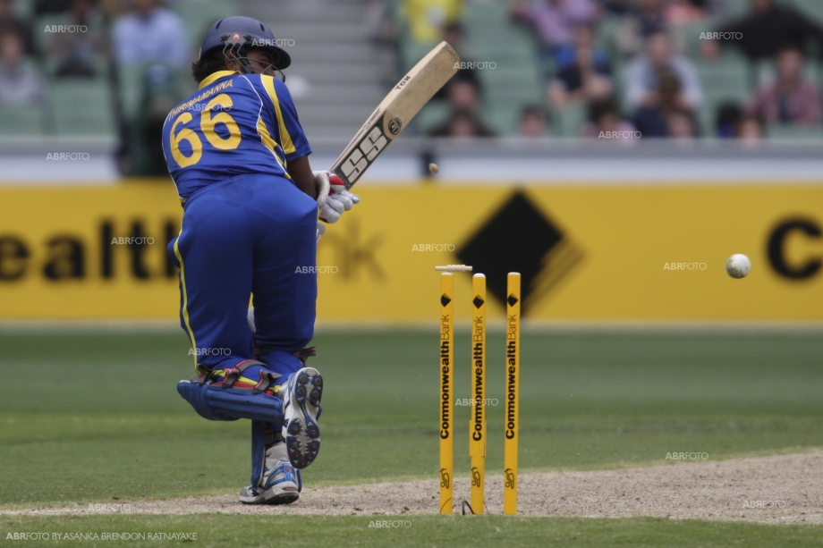 Lahiru Thirimanne hits the ball on to his stumps