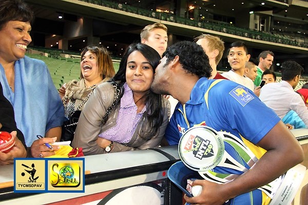 Thisara Perera gives his wife a kiss after victory