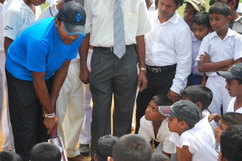 Young cricketers from Hindu College listen intently to tips from Mahela