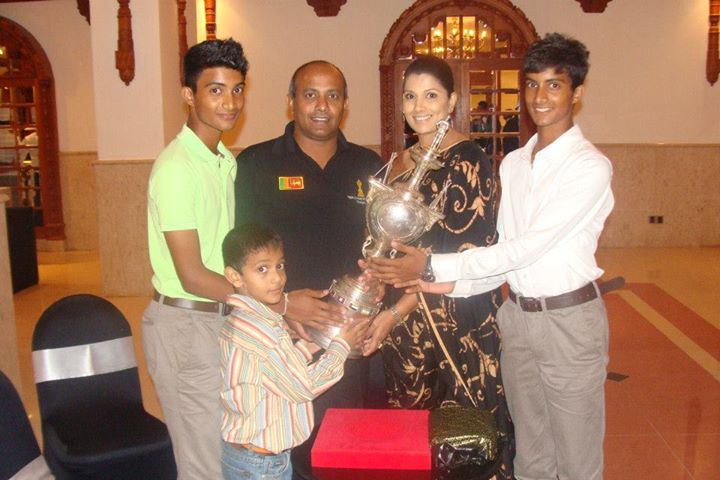 Hashan Tillakaratne's family poses with 1996 World Cup trophy