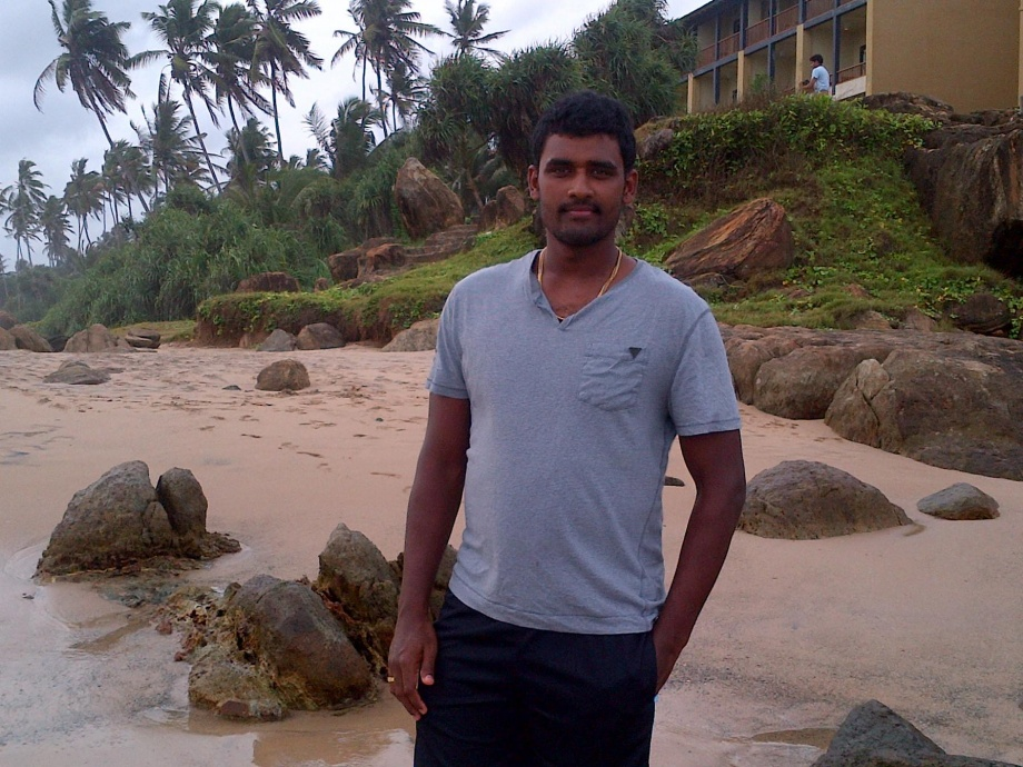 Thisara Perera posing for a photo