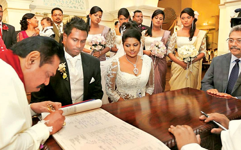 Sri Lankan president and defence secretary sign as witnesses at Angelo Mathews' wedding