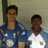 Akila Dananjaya with Mitchell Johnson from Australia