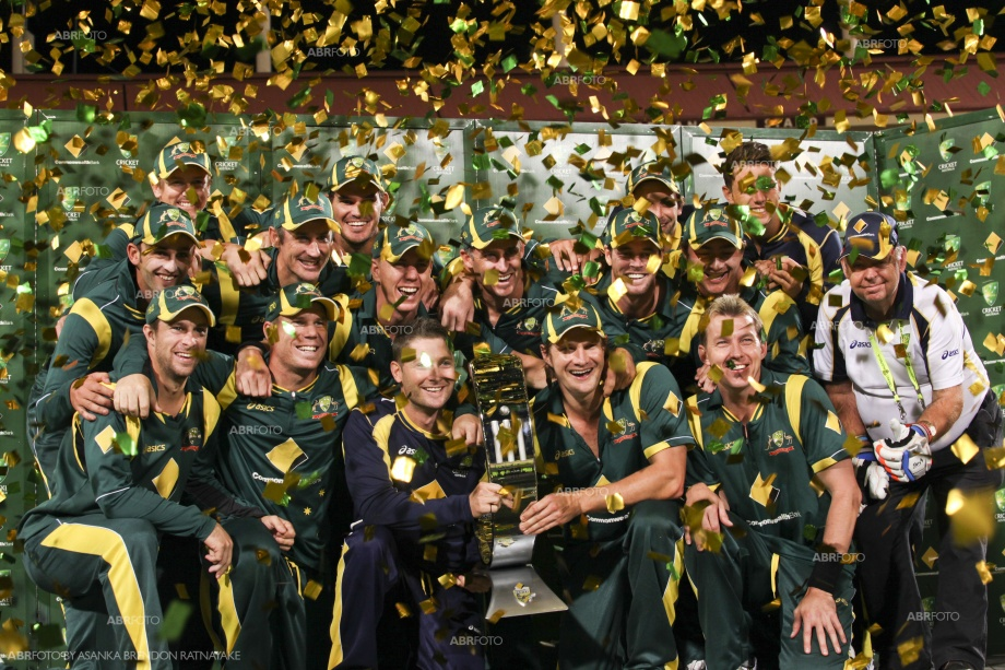 The winning Australian cricket team pose with the Commonwealth Bank Trophy