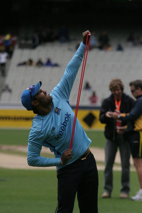 Kapugedera stretches out during practice at the MCG, Australia