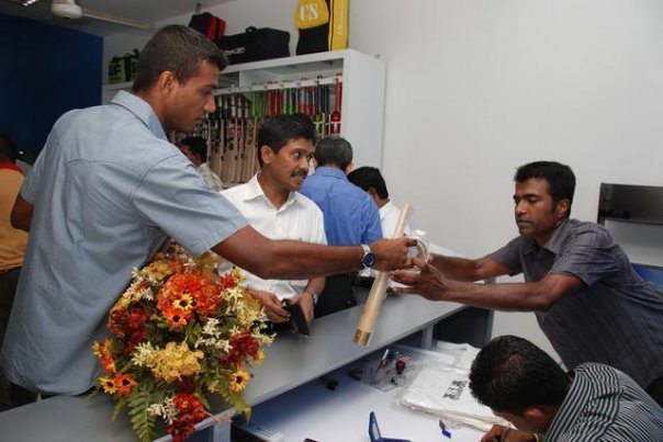 Maharoof makes a purchase at Chandana Sports