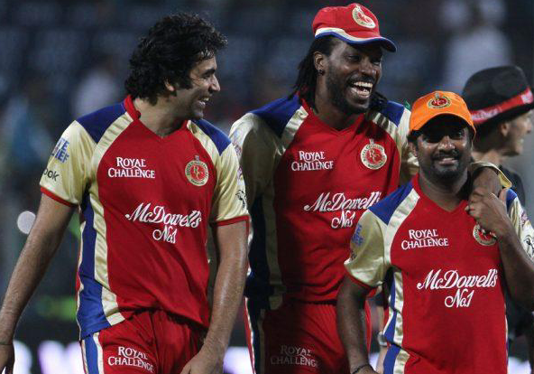 Murali wearing Gayle's orange cap