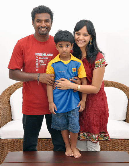 Muttaih Muralitharan with his wife Madhimalar and son