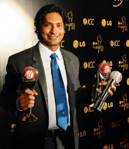 Kumar Sangakkara poses with the three trophies he won at ICC awards 2010