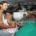 A  Sri Lankan Cricketer travels by ambulance accompanied by family members