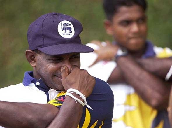Photo: Jayasuriya stretches whilst pinching his nose.