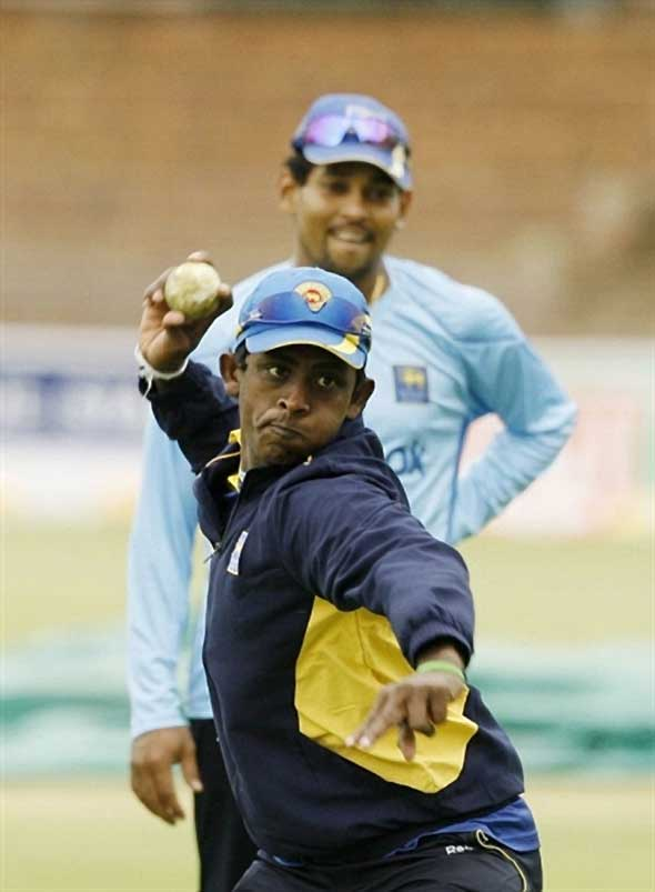 Photo: Mendis during fielding drills.