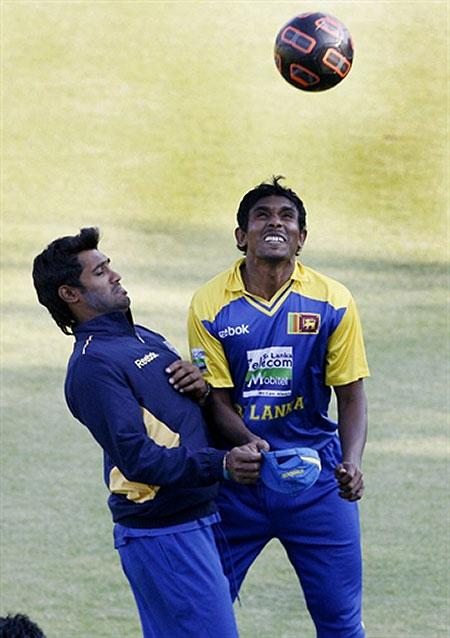 Kapugedera and Thushara play football