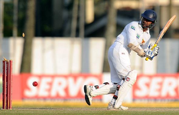 Kumar Sangakkara is bowled off his thigh pad