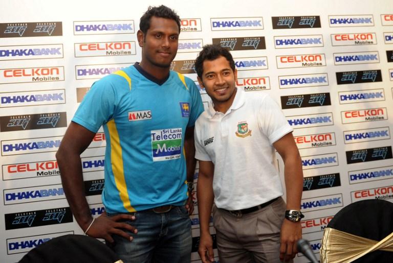 Mushfiqur and Mathews pose for photographers