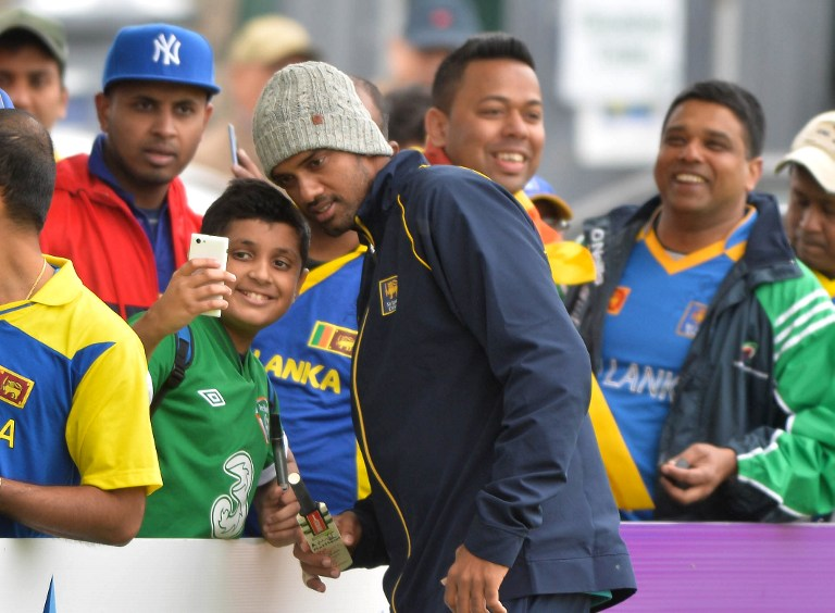 Sachithra Senanayake poses for a photo with a fan in Ireland