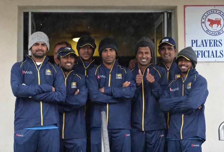 Sri Lankan players look on as rain falls down in Ireland