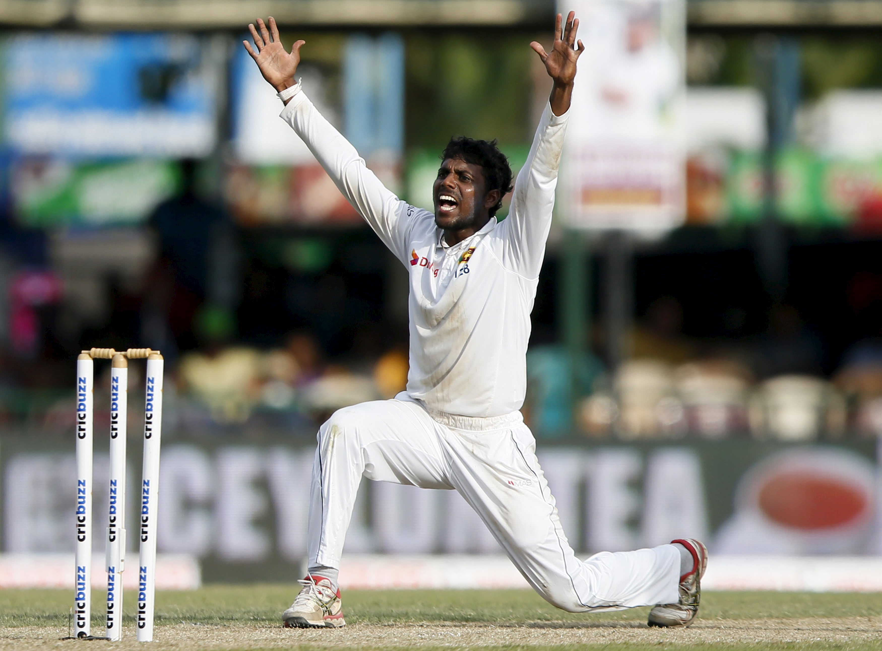 Sri Lanka's Tharindu Kaushal appeals for an unsuccessful wicket for India's Rohi